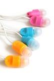 Multicolored earphones Stock Photography
