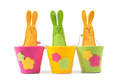 Multicolored easter bunnies sitting in row Royalty Free Stock Photo