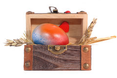 Multicolored Easter egg in the wooden gift box. Isolated on white Royalty Free Stock Photography