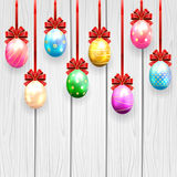 Multicolored Easter eggs with bow Stock Photo