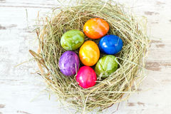 Multicolored Easter eggs in a nest Stock Photo