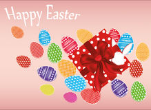 Multicolored easter eggs with pattern. A box with a gift tied with a red ribbon and a bow. Royalty Free Stock Photo