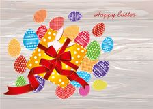 Multicolored easter eggs with pattern. A box with a gift tied wi. Th a red ribbon and a bow. An empty space for an advertising message. Greeting card. Free place Royalty Free Stock Images