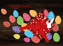 Multicolored easter eggs with pattern. A box with a gift tied wi. Th a red ribbon and a bow. An empty space for an advertising message. Greeting card. Free place stock illustration