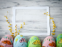 Multicolored easter eggs. On rustic wooden boards Royalty Free Stock Photography