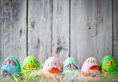 Multicolored easter eggs. On rustic wooden boards Royalty Free Stock Photo