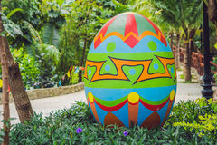 Multicolored eggs in the grass. Easter eggs hunt, outdoors. Celebrating Easter holiday Royalty Free Stock Photography