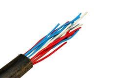 Multicolored elektrische draden in de buis Stock Afbeeldingen