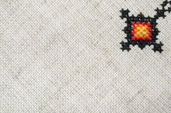 Multicolored embroidered element on linen cotton threads Royalty Free Stock Images