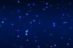 Multicolored en blauwe sterren op een blauwe achtergrond Royalty-vrije Stock Foto's