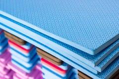 Multicolored EVA Foam puzzle mats stacked stock photos