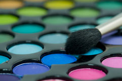 Multicolored eye shadows with brush Stock Photography