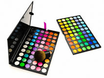 Multicolored eye shadows and cosmetics brush Royalty Free Stock Photography