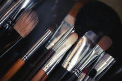Multicolored eye shadows with cosmetics brush Stock Photos