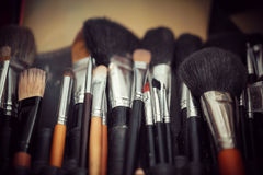 Multicolored eye shadows with cosmetics brush Stock Photography