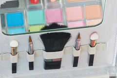 Multicolored eye shadows and cosmetics brush Royalty Free Stock Photo