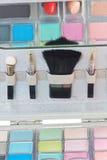 Multicolored eye shadows and cosmetics brush Royalty Free Stock Photo