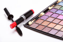 Multicolored eye shadows palette, red Lipstick and black mascara Royalty Free Stock Photography
