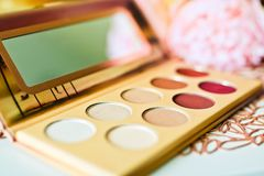 Multicolored eyeshadows palette with soft focus. Conceptual photo for beauty salon stock image