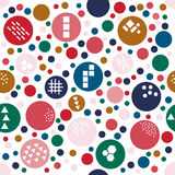Multicolored festive seamless pattern with funny polka dot of different size.. Abstract red, gold, navy blue, dark green, pink circles with texture of different Royalty Free Stock Photo