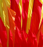 Multicolored flags. Background of multi-colored flag waving wind Stock Photos