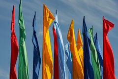Multicolored flags against the blue cloudy sky Stock Photo