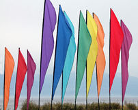 Multicolored Flags at the Beach Royalty Free Stock Photo