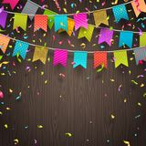 Multicolored flags garlands and colorful confetti. On a wooden background. Vector illustration Royalty Free Stock Photo