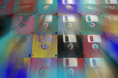 Multicolored floppy disc 3.5 for old computers. Aligned as background Royalty Free Stock Photos