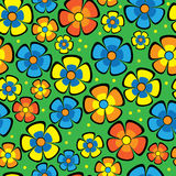 Multicolored flowers on green seamless pattern Stock Photos