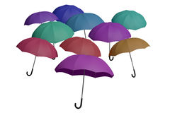 Multicolored flying umbrellas isolated over white Royalty Free Stock Photos