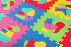 Multicolored foam puzzle Royalty Free Stock Photography