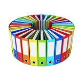 Multicolored folders forming a circle on white Royalty Free Stock Photo