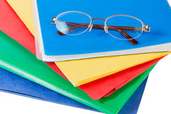 Multicolored folders with glasses isolated Royalty Free Stock Photos