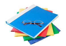 Multicolored folders with glasses on white Stock Image