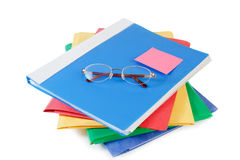 Multicolored folders with glasses on white background Royalty Free Stock Photos