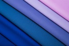 Multicolored folds of blue, lilac and pink fabric. Multicolored folds of blue, blue, lilac and pink fabric royalty free stock photo