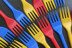 Multicolored forks. Over black background Stock Photos