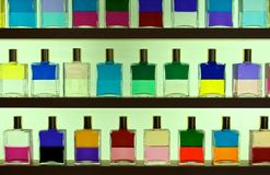 Multicolored fragrant oils in display bottles Stock Images