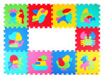 Multicolored frame of foam puzzle Royalty Free Stock Images