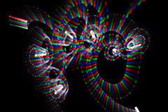 Multicolored freezelight in form of spirals. Abstract multicolored freezelight in form of spirals on black background stock photos