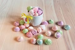 Multicolored  French meringue. On a wooden background Royalty Free Stock Photography