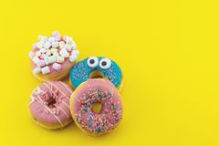 Multicolored funny donuts Royalty Free Stock Images