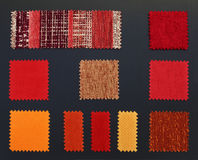 Multicolored furniture fabric samples. Catalog Stock Photos