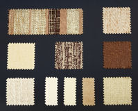Multicolored furniture fabric samples. Over dark background Royalty Free Stock Images