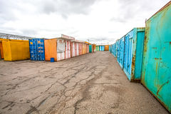 Multicolored garages in the industrial area witn asphalt road Stock Image