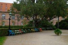 Multicolored garden chairs at Det kongelige Biblioteks Have. Copenhagen, Denmark royalty free stock photos
