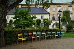 Multicolored garden chairs at Det kongelige Biblioteks Have. Copenhagen, Denmark royalty free stock photography