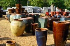 Multicolored garden pots stock photo