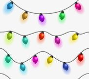 Multicolored garlands seamless pattern. Beautiful holidays decorations. Christmas lights on white background. Multicolored garlands seamless pattern. Beautiful Stock Photography
